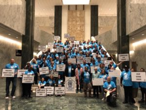 Group photo of the Under One Roof coalition of upstate landlords in the legislative building in Albany, NY